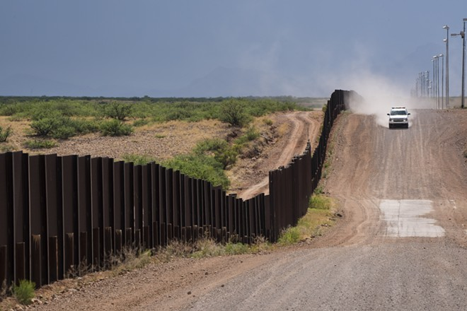 A U.S. Border Patrol vehicle drives along the Mexican border on a rancher's property in Naco, Ariz., June 9, 2016. More than 500 employees of the United States' primary border security agency were charged with drug trafficking, accepting bribes and a range of other crimes over a two-year period, according to reports released on Oct. 12, 2018. Customs and Border Protection, the Border Patrol's parent agency, employs over 60,000 people. - TODD HEISLER/THE NEW YORK TIMES
