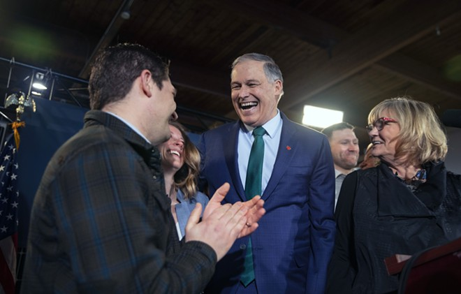 Gov. Jay Inslee is joined by his son Joe, left, and his wife Trudy as he announces his candidacy for the presidency at A&R Solar, an installation company, in Seattle, Wash., on Friday, March 1, 2019. Inslee, a former member of Congress who has made climate change and the environment his signature issues, jumped into the crowded field of 2020 Democratic contenders for president on Friday. - RUTH FREMSON/THE NEW YORK TIMES