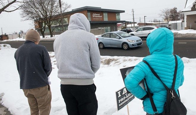 Two Catholic seminarians and a Catholic parishioner pray the Rosary of the Unborn outside of Planned Parenthood in February. - DANIEL WALTERS PHOTO