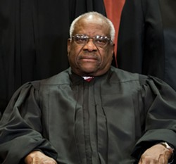 Associate Justice Clarence Thomas joins the rest of the Supreme Court justices in sitting for a group photo in Washington on Nov. 30, 2018. On March 20, 2019, as Curtis Flowers's lawyer concluded her argument, Thomas asked his first questions from the bench since 2016. Thomas holds the modern record for silence on the bench. Before his questions in 2016, he had gone a decade without asking one. - DOUG MILLS/THE NEW YORK TIMES