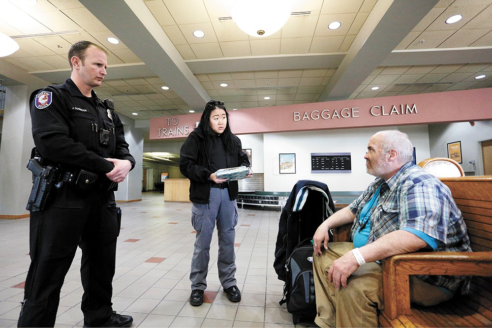 Officer Joe Dunsmoor and Jae Dobbs talk with Dennis Michael Cronin. - YOUNG KWAK PHOTO