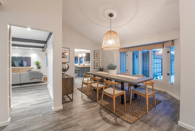 Textures and shadows add interest in the welcoming dining area. The airy quality of the relatively large light fixture keeps it from overpowering the space. - ERICK DOXEY PHOTO