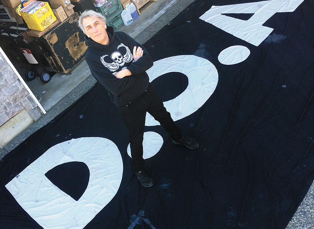 Joe Keithley poses with the fabled D.O.A. backdrop.