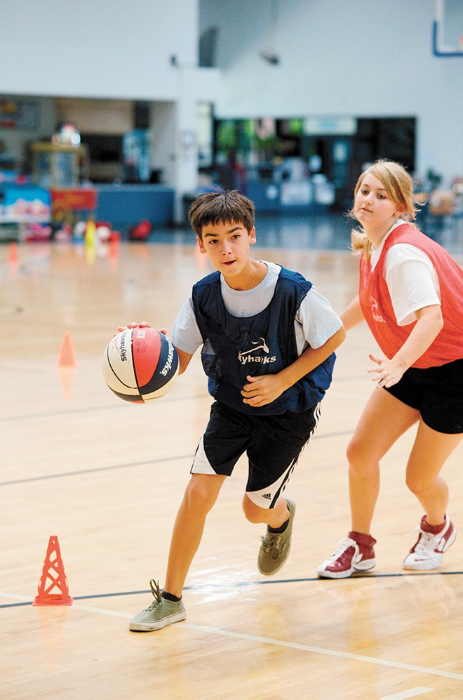 Sharpen your shooting and ball handling skills at one of Skyhawks' many basketball camps.