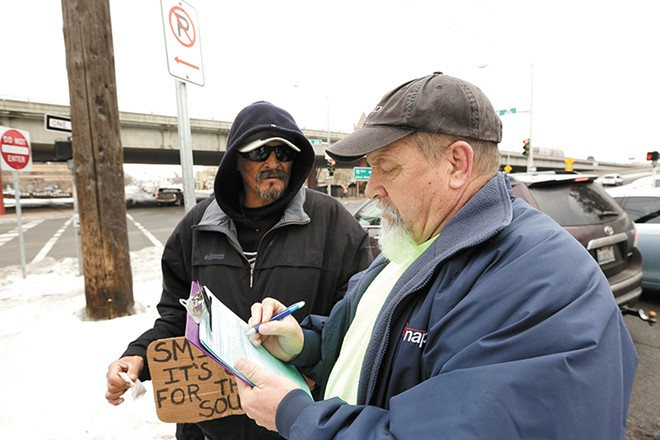 Unlike last year, when surveyors like Bob Peeler recorded homeless residents' answers on paper, this year the city is upgrading to a smartphone app. - YOUNG KWAK PHOTO