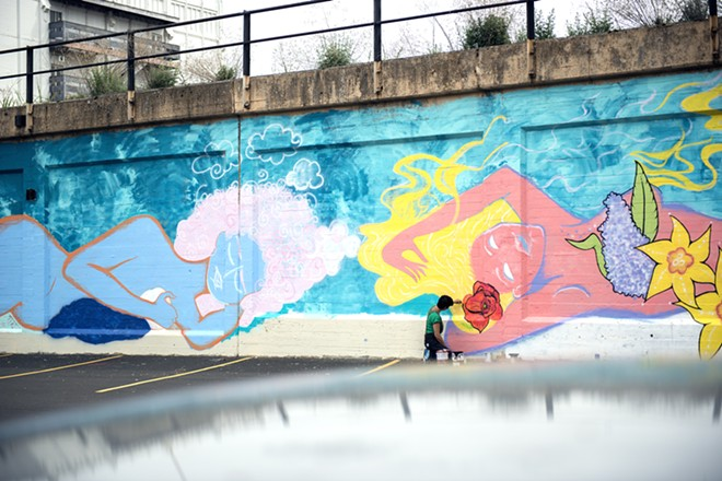 A portion of the 160-foot mural in progress. - DEREK HARRISON PHOTO