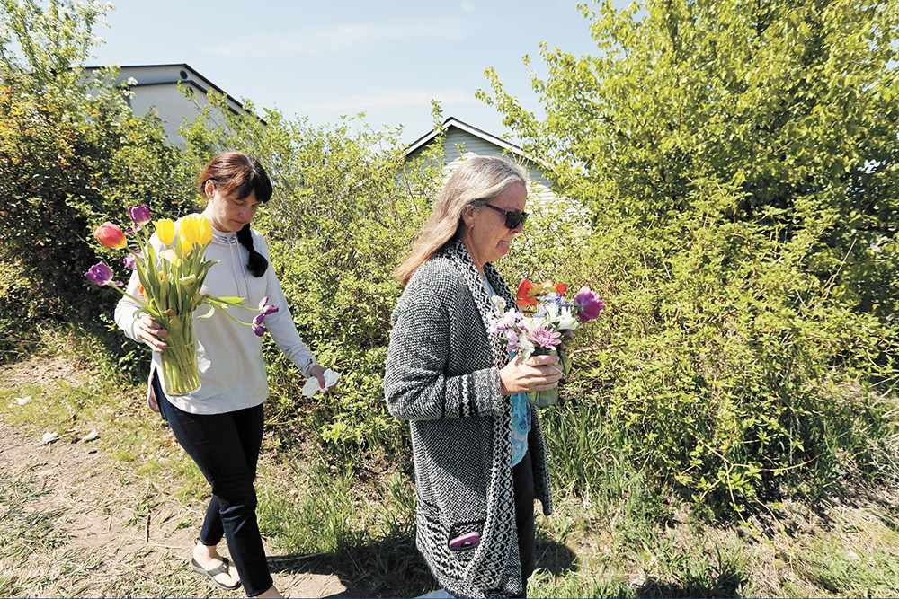 Justine Murray (left) and her mother, Margie Polkowski, bring flowers to the site where Ethan was killed. - YOUNG KWAK PHOTO
