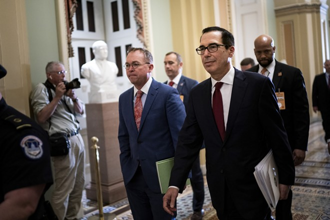 Mick Mulvaney, left, the acting White House chief of staff, and Treasury Secretary Steven Mnuchin head to a hearing of the House Financial Services Committee on Capitol Hill, in Washington, May 22, 2019. Mnuchin said Wednesday he was trying to determine who in the Internal Revenue Service wrote a draft legal memo concluding that he must release President Donald Trump's tax returns to Congress, and he insisted that he disagreed with its findings. - ERIN SCHAFF/THE NEW YORK TIMES