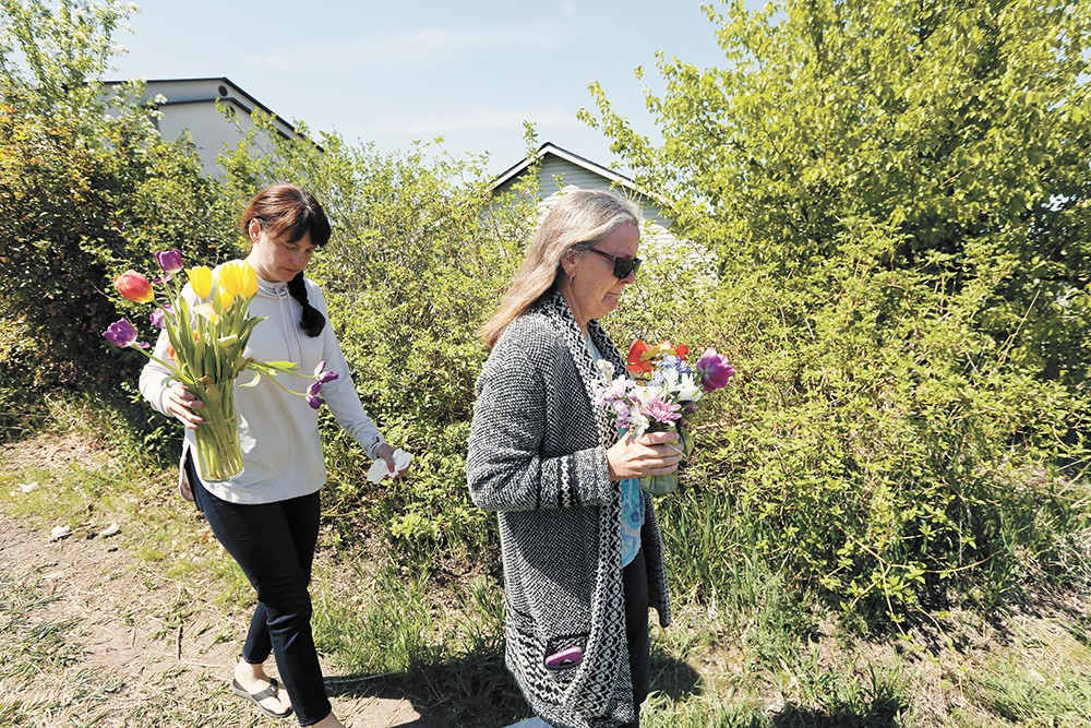 Justine Murray (left) and her mother, Margie Polkowski, bring flowers to the site where Ethan Murray was killed.