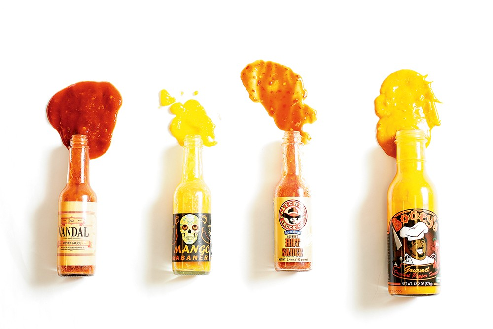 All four of these hot sauces are made in the Inland Northwest. - YOUNG KWAK PHOTO