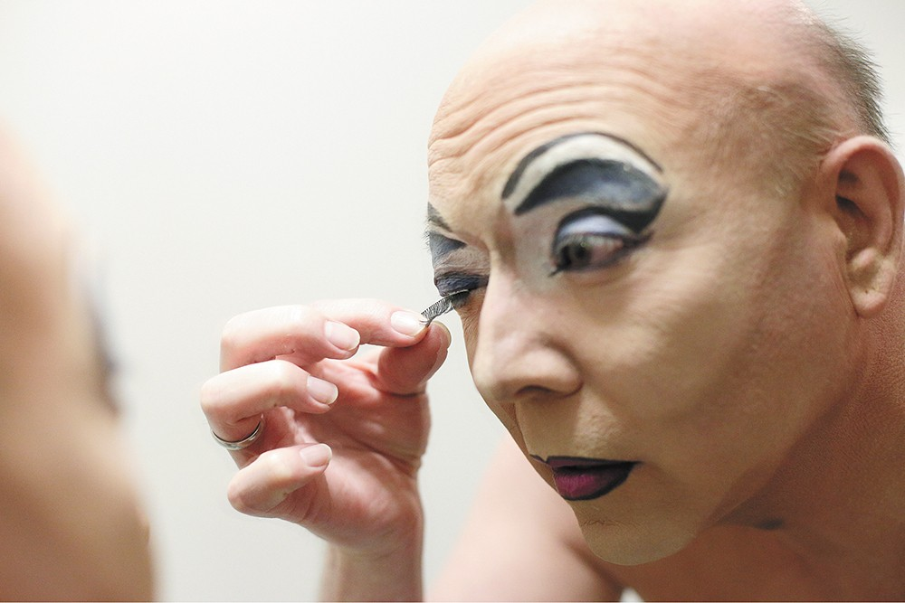 Jason Johnson applies fake eyelashes, one of the final steps in his transformation to Nova Kaine. - YOUNG KWAK PHOTO