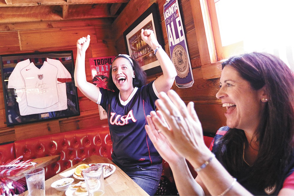 Sonia Martinez, left, and Deb Brock celebrate a U.S. goal in the Women's World Cup at Geno's. - YOUNG KWAK