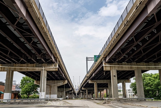 A lot beneath a highway in Baltimore that helped a development owned by a Maryland billionaire and Goldman Saches qualify for a valuable tax break. - MATT ROTH/PROPUBLICA