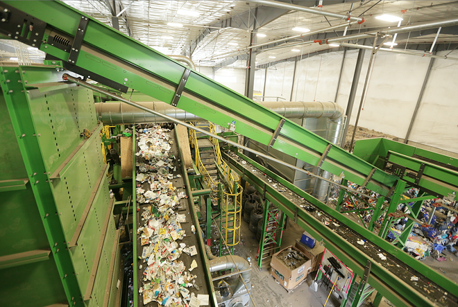 Materials at Waste Management's SMaRT Center are sorted from a single stream into paper, cardboard, plastics, aluminum and more. - YOUNG KWAK PHOTO