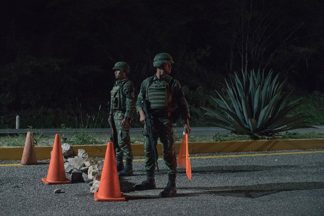 Soldiers working with Mexico's National Guard at an immigration checkpoint in Comitán de Domínguez, Mexico, June 15, 2019. Increased enforcement along the border with Guatemala, which began in recent days, has made crossing into Mexico harder. This has dissuaded migrants from traveling north. - LUIS ANTONIO ROJAS/THE NEW YORK TIMES