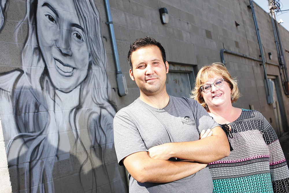 Artist Cody Peone and Garland Business District President Julie Shepard-Hall (left), along with several of the district's existing murals. - YOUNG KWAK PHOTO