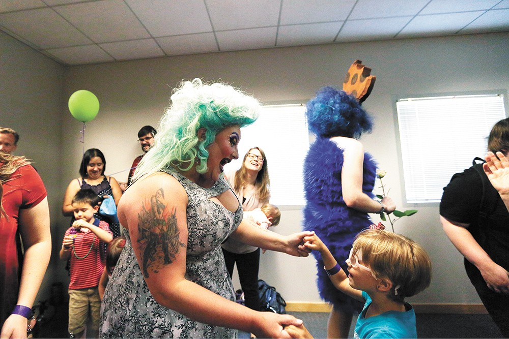 Tirrany Hex, left, dances with 6-year-old Klara Wisner during Drag Queen Story Hour at the Spokane Public Library South Hill. - YOUNG KWAK PHOTO