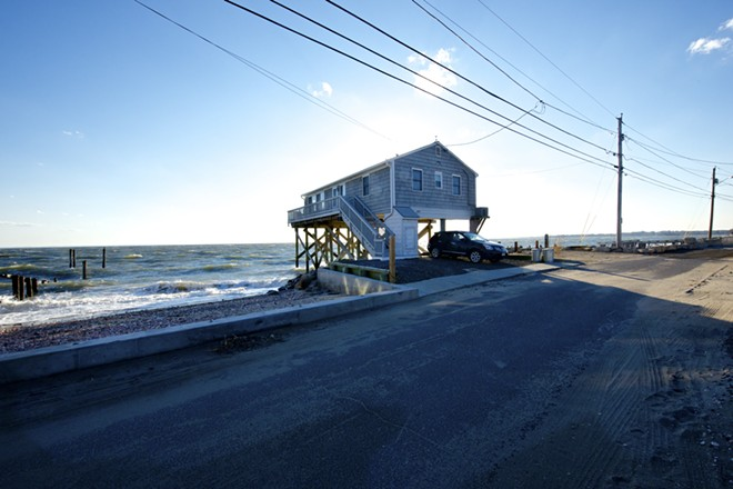 A home on stilts along the water in Fairfield Beach, Conn., Oct. 26, 2013. Increased awareness of climate change has not diminished Americans' appetite for building homes in flood zones, new data show. - JANE BEILES/THE NEW YORK TIMES