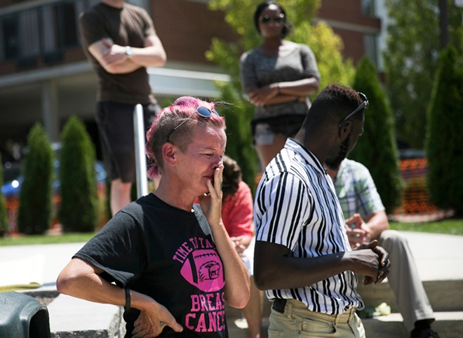 Mourners at a vigil in Dayton, Ohio, where a mass shooting took place early Sunday morning, only hours after a mass shooting in El Paso, Texas, Aug. 4, 2019. In a country that has become nearly numb to men with guns opening fire in schools, at concerts and in churches, the back-to-back bursts of gun violence in less than 24 hours were enough to leave the public stunned and shaken. - MADDIE MCGARVEY/THE NEW YORK TIMES