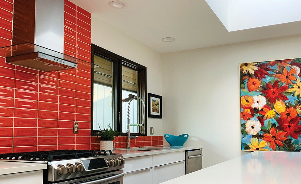 """Willing to be bold, and reflecting on the year of their home and their love of midcentury pieces, bright orange ceramic tile gave this space an instant wow factor."" — Jana Oliveri - PHOTO COURTESY HUE"