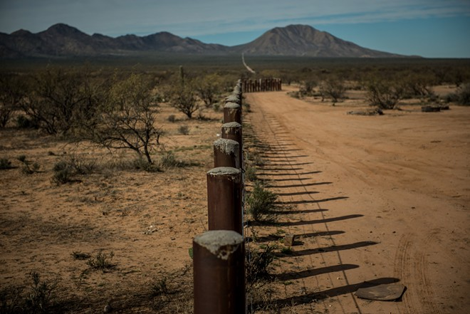 "The border between the United States and Mexico is demarcated by posts in the Tohono O'odham nation in Arizona, Jan. 21, 2019. The president has repeatedly suggested during meetings on immigration policy that aides ""take the land"" and ""get it done,"" according to a person who has heard him say it. - MERIDITH KOHUT/THE NEW YORK TIMES"