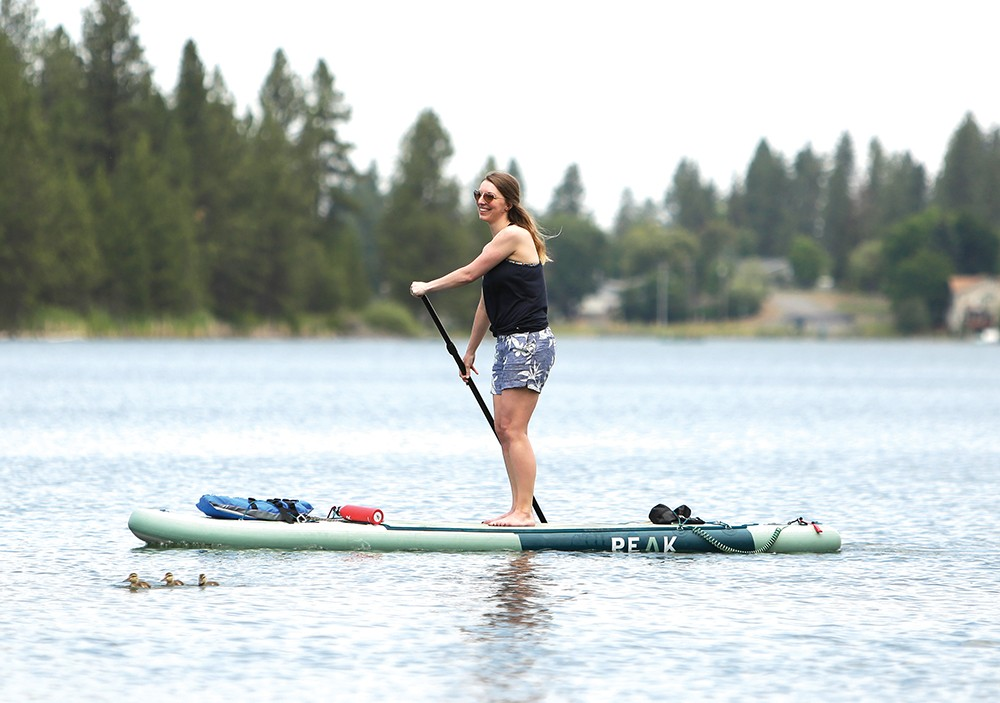 Ali Blackwood paddles across Medical Lake, a nearby favorite ideal for beginners. - YOUNG KWAK PHOTO