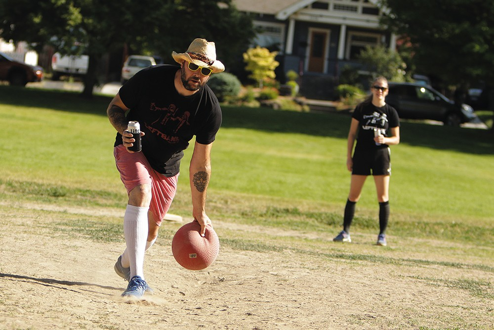 Sole Fighters' Isaac Gordon pitches during a BigFoot KickBall League game against Fresh Pints of Ball-Air at Grant Park. - YOUNG KWAK PHOTO
