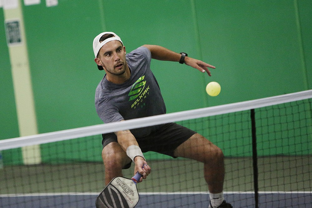 Tyson McGuffin playing a doubles exhibition match at the North Park Athletic Club. |young kwak photo - YOUNG KWAK PHOTO