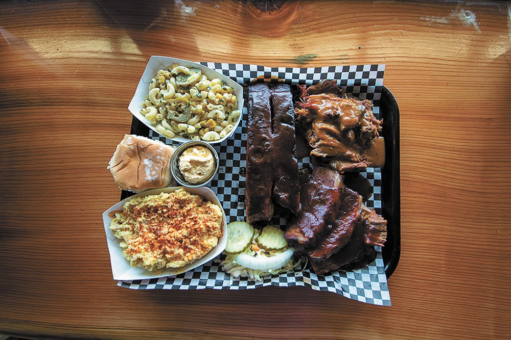 The Texas trifecta: ribs, pulled pork and brisket at the Outlaw BBQ. - STUART DANFORD PHOTO
