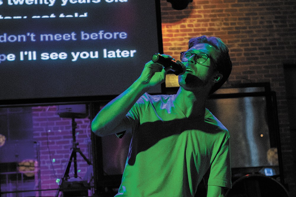 Bennett Gladden sings karaoke at nYne Bar in Spokane. - ERICK DOXEY PHOTO