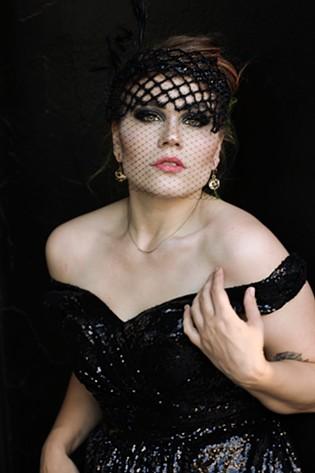 Ali James models the black sparkly dress that inspired #samedressspokane. - RACHEL FELLOWS PHOTO