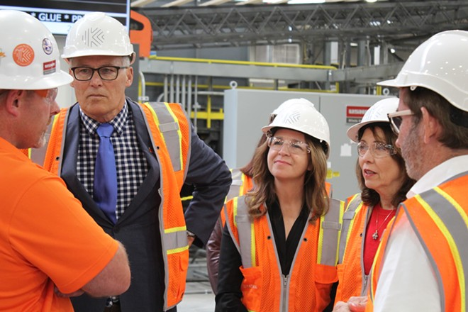 Washington Gov. Jay Inslee (second from left), Commissioner of Public Lands Hilary Franz, and U.S. Sen. Maria Cantwell get a tour of the Katerra cross-laminated timber facility in Spokane Valley on Friday, Sept. 20, 2019. - SAMANTHA WOHLFEIL PHOTO