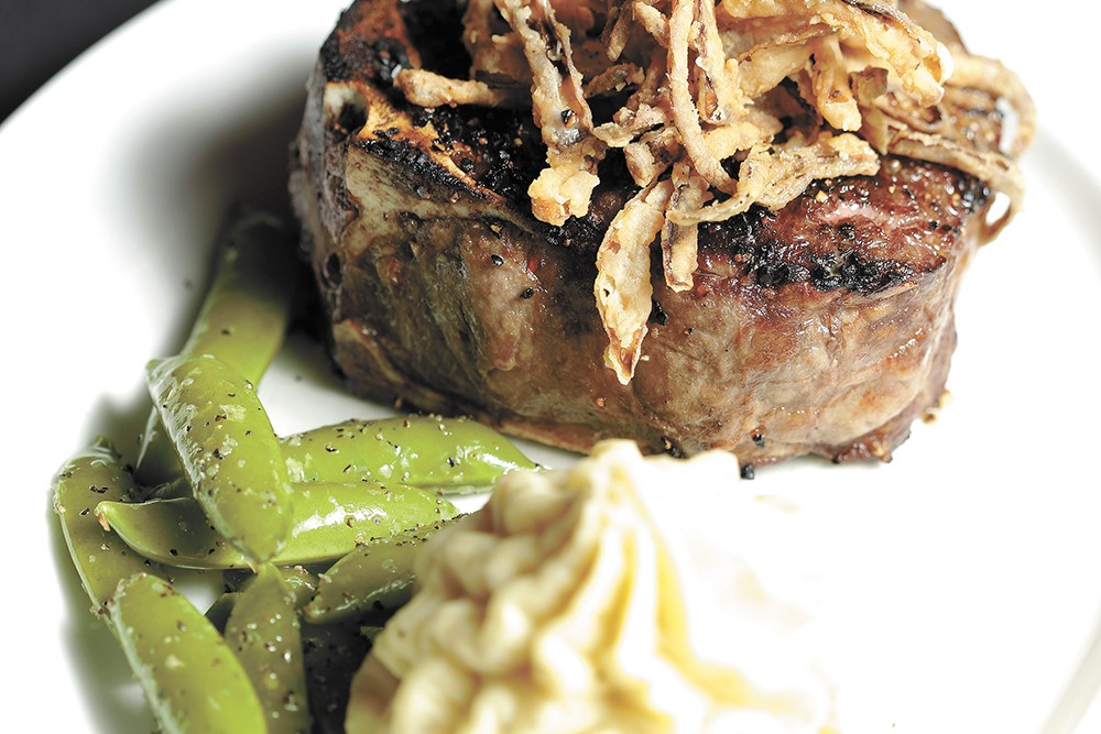 Churchill's 16-ounce bone-in tenderloin with garlic mashed potatoes and sugar snap peas. - YOUNG KWAK PHOTO