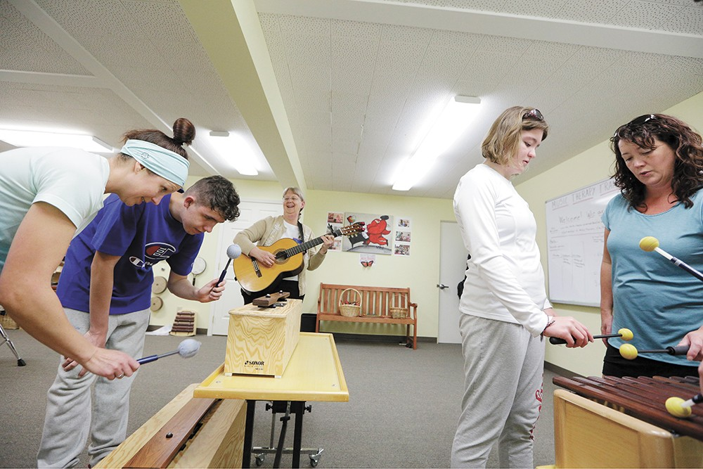 Music and Play Therapist Kim McMillin leads a music therapy session for 14-year-old Evan Hannah, center, who is diagnosed with autism, and his mother Kerry at the Center for Music Therapy in Spokane. - YOUNG KWAK PHOTO