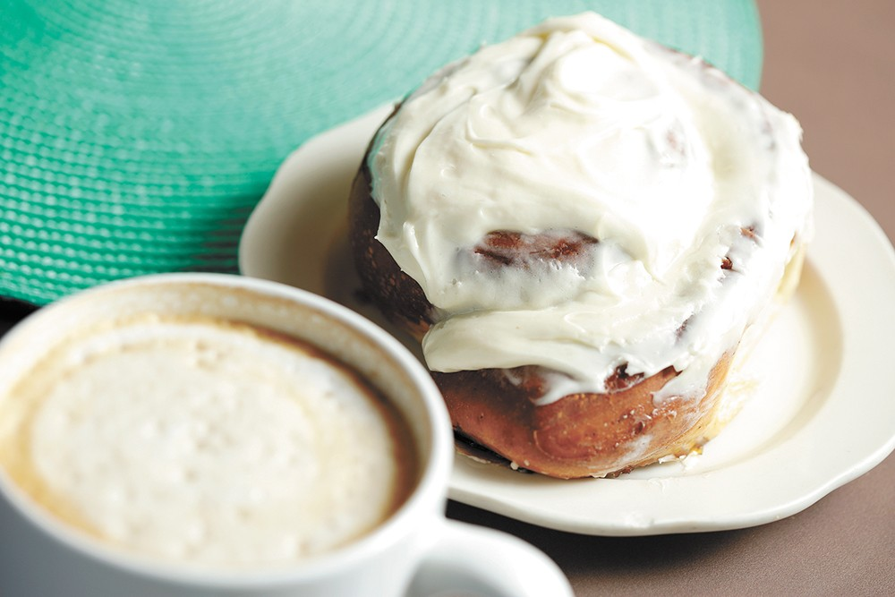 Maple Street Bistro's cinnamon roll doesn't skimp on the frosting. - YOUNG KWAK PHOTO