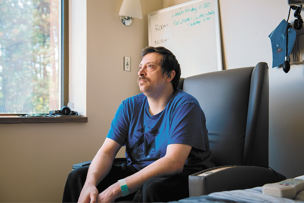 Benjamin, 35, has called this room at Sacred Heart Medical Center his home for over seven months. - ERICK DOXEY PHOTO