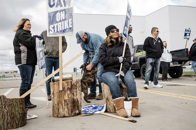 Striking General Motors employees picket outside the company's Flint Engine Operations Plant in Flight, Mich., on Oct. 17, 2019. The strike affected the count for the October jobs report. - ERIN KIRKLAND/THE NEW YORK TIMES