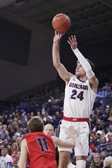 Gonzaga forward Corey Kispert (24) shoots over Lewis-Clark State guard Hodges Bailey. - YOUNG KWAK
