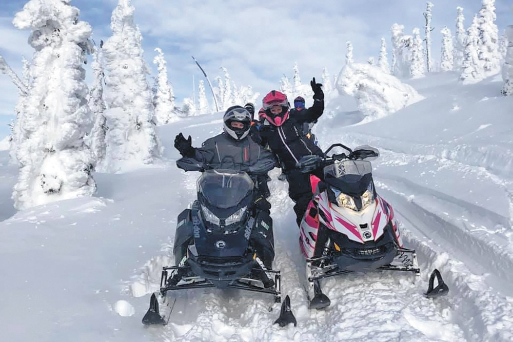Members of the Spokane Winter Knights Snowmobile Club. - SPOKANE WINTER KNIGHTS
