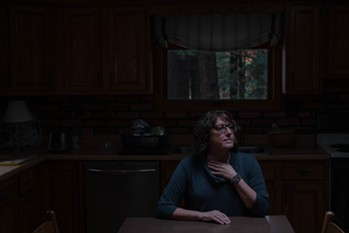 Janine Dunphy at her family cabin. In 2014, Dunphy reported that Mark Papamechail, a registered sex offender, had raped her at his home after the two had met through PlentyofFish. Dunphy saw Papamechail back on the app in 2016. - SARAH RICE FOR PROPUBLICA