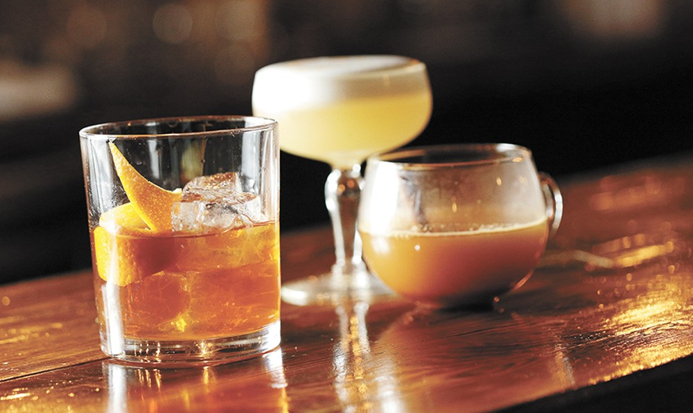 From left to right: Chai-infused old fashioned, whiskey sour and Farmer's Bishop punch. - YOUNG KWAK
