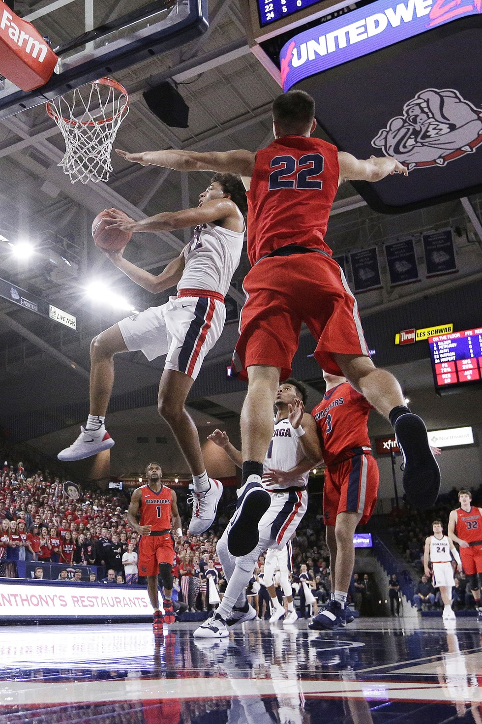 Gonzaga forward Anton Watson soars toward the hoop in November's exhibition against Lewis-Clark State. - YOUNG KWAK PHOTO