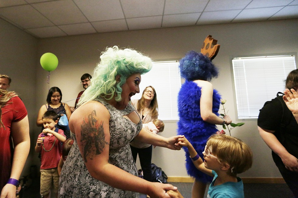After reading Jane Yolen's Not All Princesses Dress in Pink, Tirrany Hex, left, dances with 6-year-old Klara Wisner during the Drag Queen Story Hour in June at the South Hill Spokane Public Library. - YOUNG KWAK PHOTO