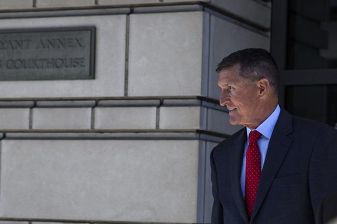 Michael Flynn, President Donald Trump's first national security adviser, leaves federal court in Washington after a sentencing hearing on July 10, 2018. Federal prosecutors recommended on Tuesday, Jan. 7, 2020, that Flynn be sentenced to up to six months in prison for lying to investigators in the Russia inquiry, a reversal that came after he backed off his cooperation deal and even began suggesting that he had not committed any crimes. - SAMUEL CORUM/THE NEW YORK TIMES