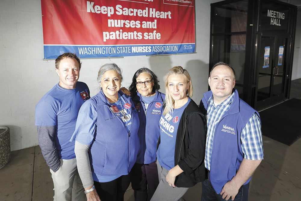 Sacred Heart nurses and members of the negotiation team outside the union hall in October. - YOUNG KWAK PHOTO