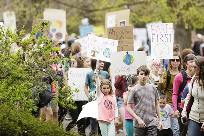 7 year old Theia Garrettson, left, 11 year old Creeley Chanse march on the Centennial Trail in Riverfront park during the March for Science in 2017. - YOUNG KWAK PHOTO