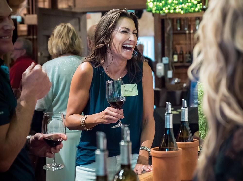 Guests enjoy the tasting room at Dunham Cellars. - KARI NOACK PHOTO