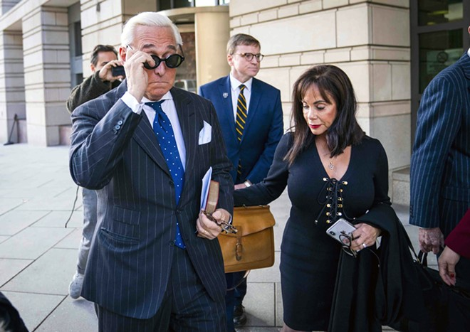 Roger Stone, accompanied by his wife, Nydia Stone, leaves federal court in Washington on Nov. 14, 2019, after being convicted of seven felonies for obstructing a congressional inquiry, lying to investigators under oath and trying to block the testimony of a witness. The Justice Department will back off its sentencing recommendation for Stone, President Donald Trump's former campaign adviser and longtime friend, a senior department official said Tuesday, Feb. 11, 2020. - DOUG MILLS/THE NEW YORK TIMES