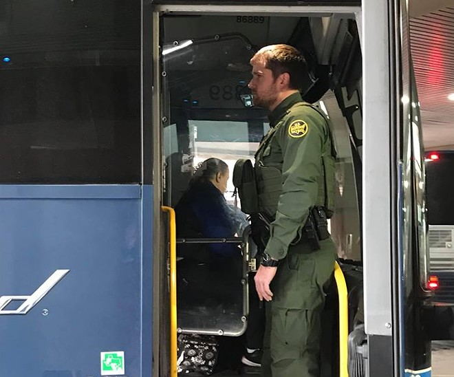 A Border Patrol agent boards a Greyhound bus on Dec. 21, 2019. A Jan. 28 memo specifies that Border Patrol must have the driver's or company's permission. - DAVID BROOKBANK PHOTO