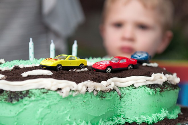 Could this photo of this 3-year-old's car-related birthday cake someday be used to steal his identity? - DANIEL WALTERS PHOTO